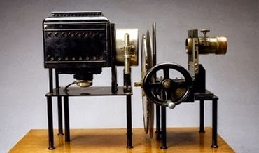first projector invented